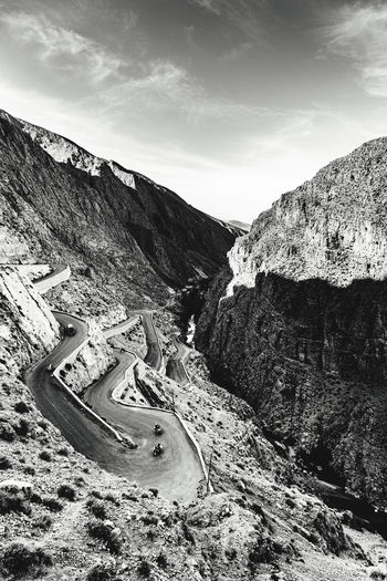 High angle view of road by mountain against sky