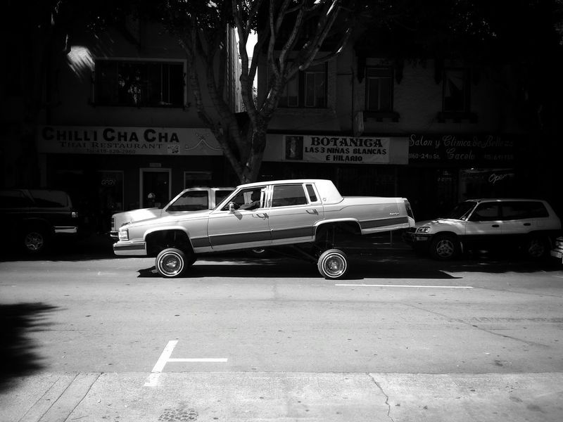 Mission District San Francisco Low Rider  24th Street  Sunday Afternoon Black And White Cruising Street Photography Shades Of Grey B&w Street Photography