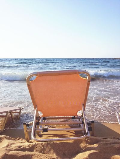 View on a Deckchair in front of an Ocean. Beach Sand Sea Vacations Travel Destinations Clear Sky Summer Sunlight Horizon Blue Sunbed Waves Sun Bed Horizon Over Water Water Deckchair Tranquility Outdoors No People Nature Summertime Closeup Lifestyles Background Sky