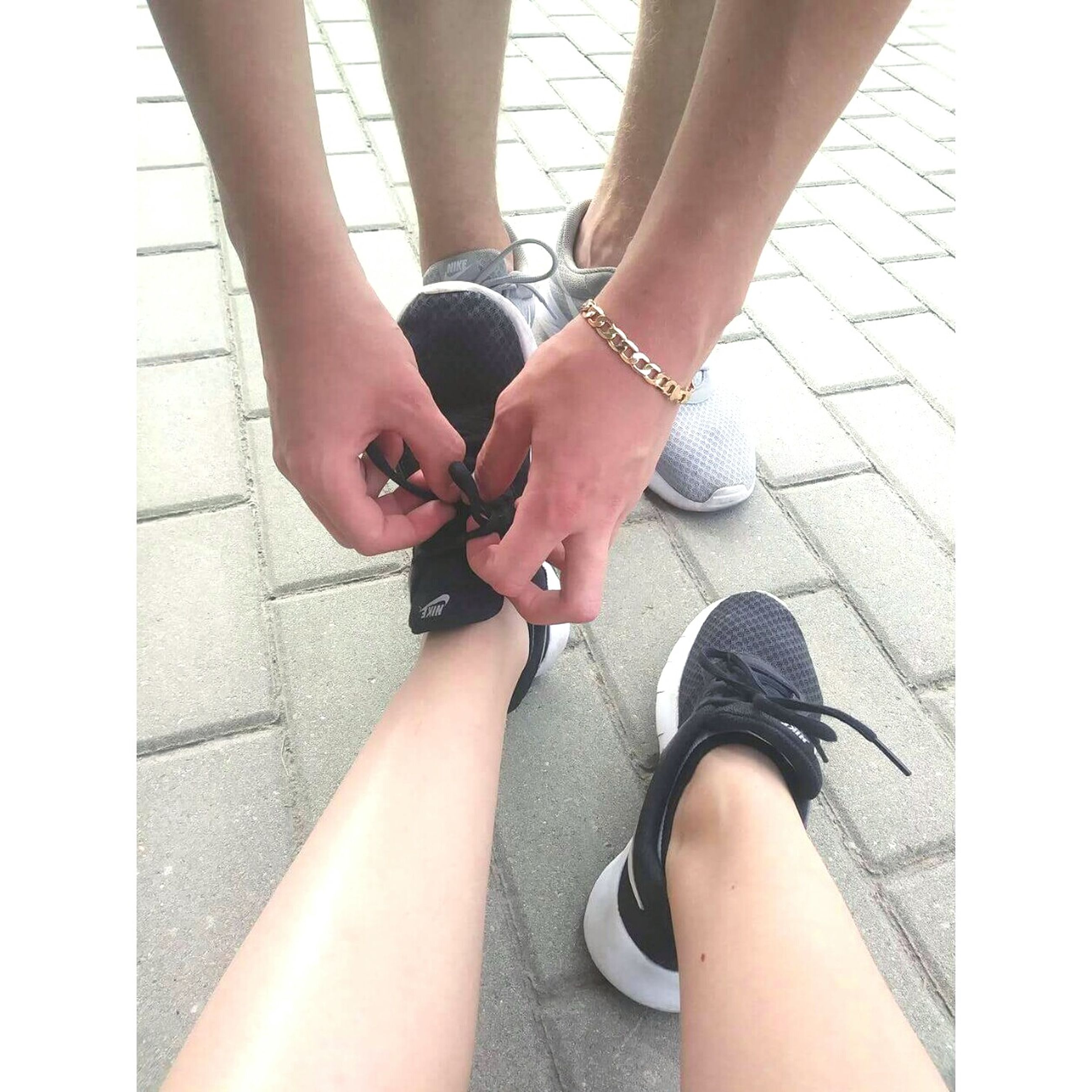 day, outdoors, two people, real people, low section, high angle view, women, human leg, human body part, human hand, close-up