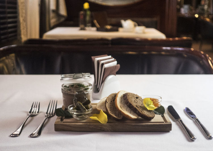 Fresh pate with bread on wooden board Board Bread Close-up Cutlery Day Food Food And Drink Fork Fresh Freshness Healthy Eating Indoors  No People Pate Plate Table Table Knife Wooden