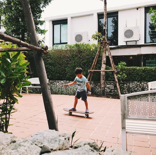 Architecture Boys Building Building Exterior Built Structure Casual Clothing Child Childhood Day Full Length Innocence Leisure Activity Lifestyles Males  Men Nature One Person Outdoors Plant Real People