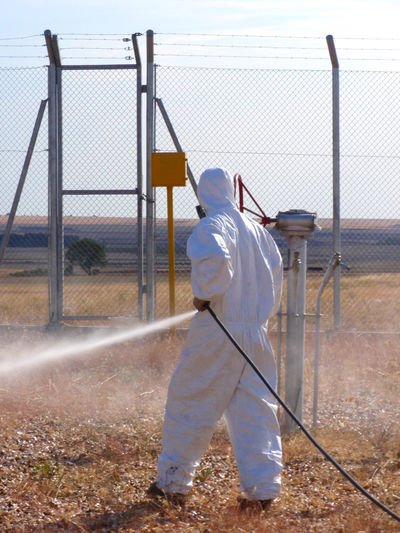 Fumigate Fumigating Fumigation  Gas Gas Mask Herbicide Man Man Working One Person Pest Pest Control Pipeline Plague Poison Poisonous Pulverize Real People Safety Security Spray Spraying Toxic Work Place Working Workplace Business Stories Business Stories