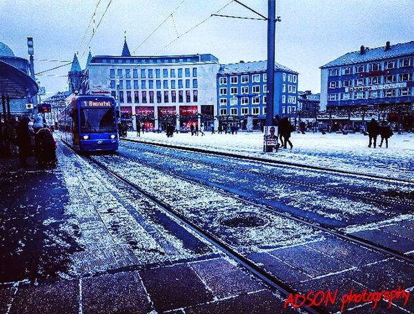 Snow Snow ❄ Transportation Winter City AMMAR ADSON ADSONphotography ADSON....📷❤ City Land Vehicle Railroad Track Public Transportation Mode Of Transport Building Exterior Outdoors Built Structure Architecture No People Sky Day Christmas Tree ماضي Holiday - Event Tree Midnight