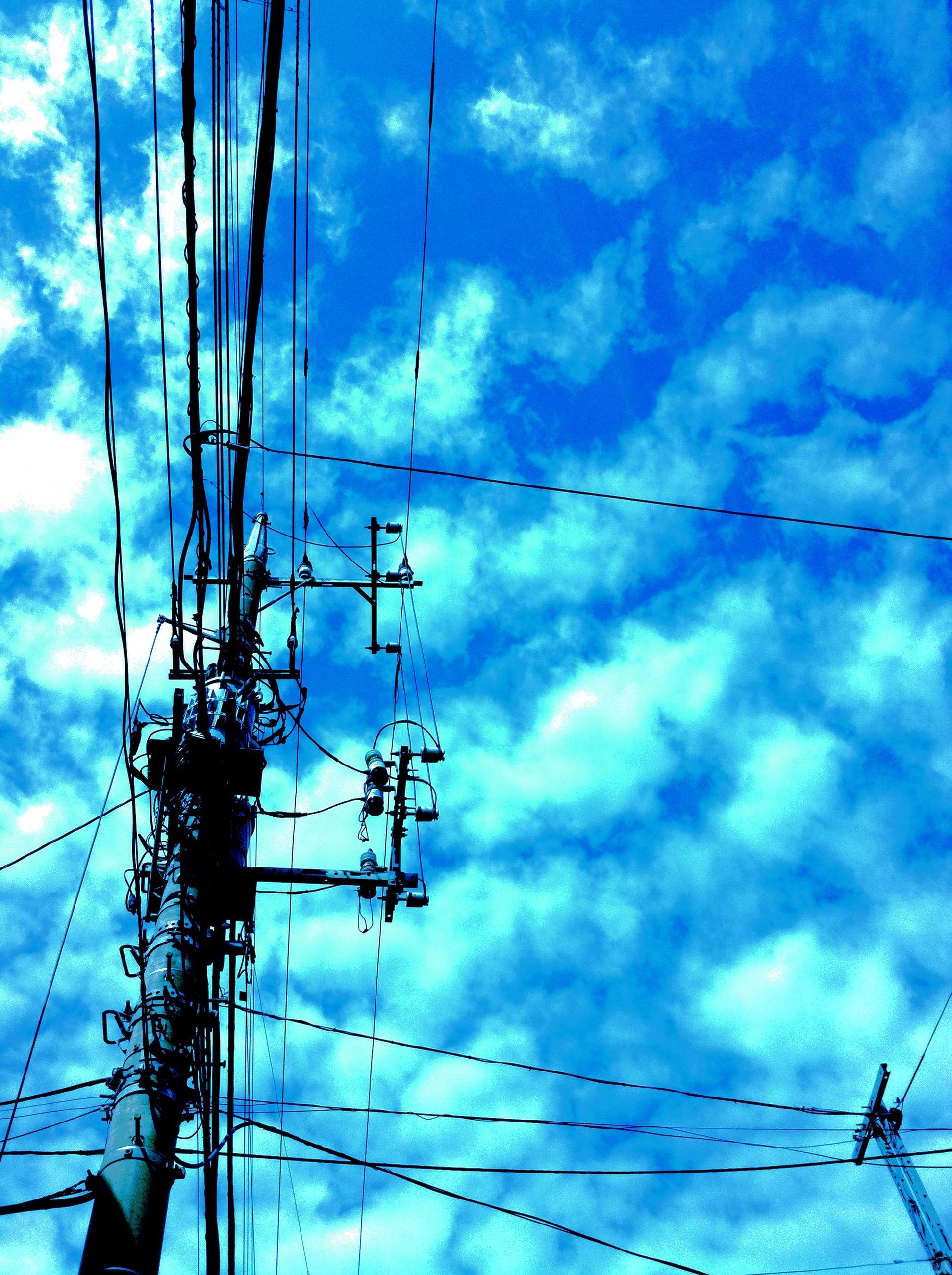 power line, electricity pylon, electricity, power supply, low angle view, cable, connection, fuel and power generation, sky, technology, cloud - sky, cloudy, cloud, complexity, blue, power cable, no people, day, outdoors, electricity tower