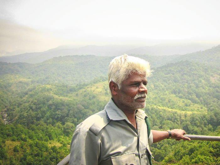 Enjoy The New Normal Chillingout One Man Only Nature Tree Mountain One Person Beauty In Nature Sky Close-up Adult Silentvalley Kerala India Forest Guard Onmarket