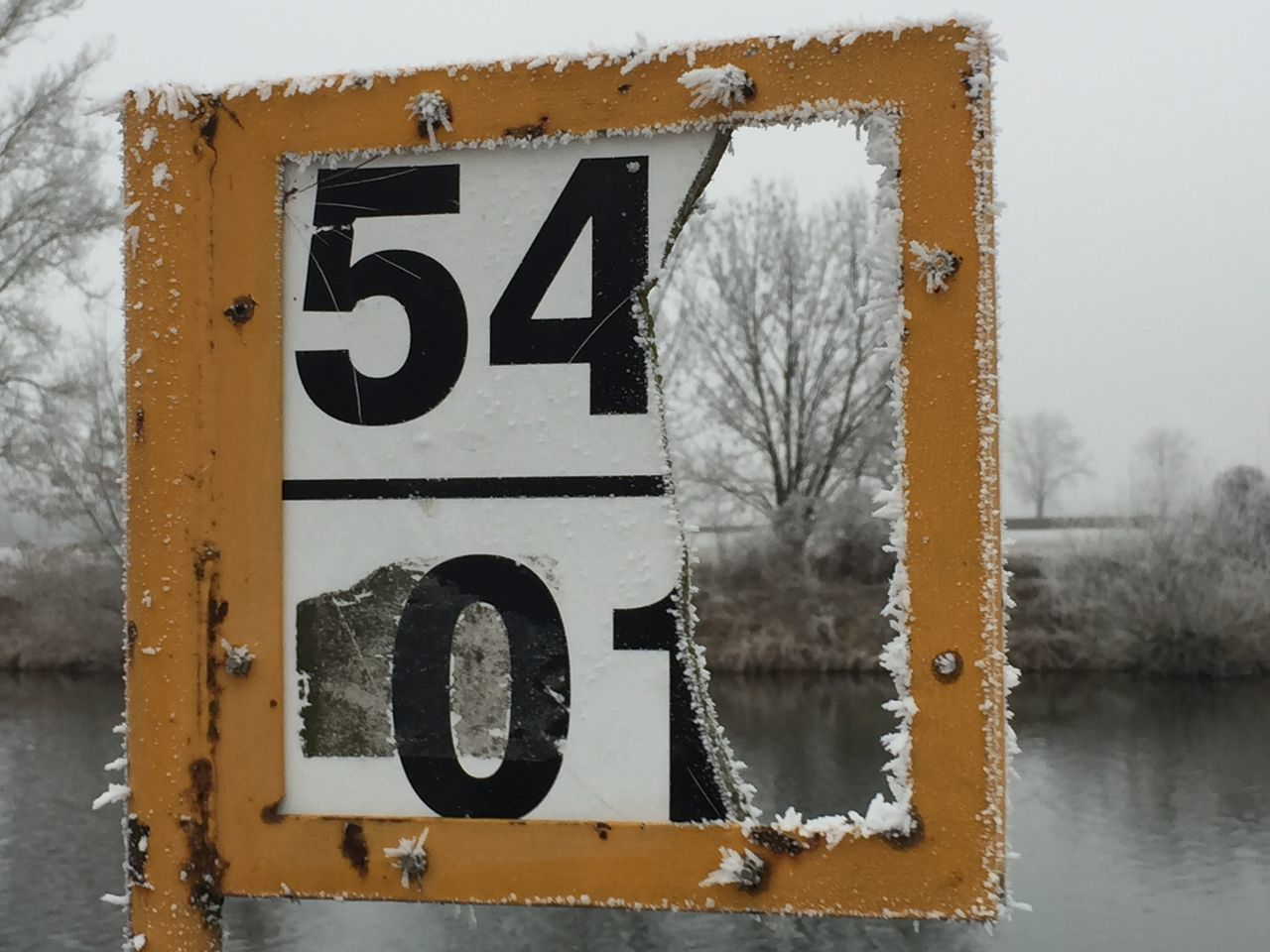 CLOSE-UP OF SIGN ON SNOW