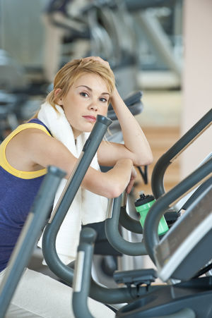 young beautiful sportive woman in gym Blond Hair Day Exercise Equipment Exercising Gym Health Club Healthy Lifestyle Indoors  Leisure Activity Lifestyles One Person Real People Self Improvement Young Adult Young Women
