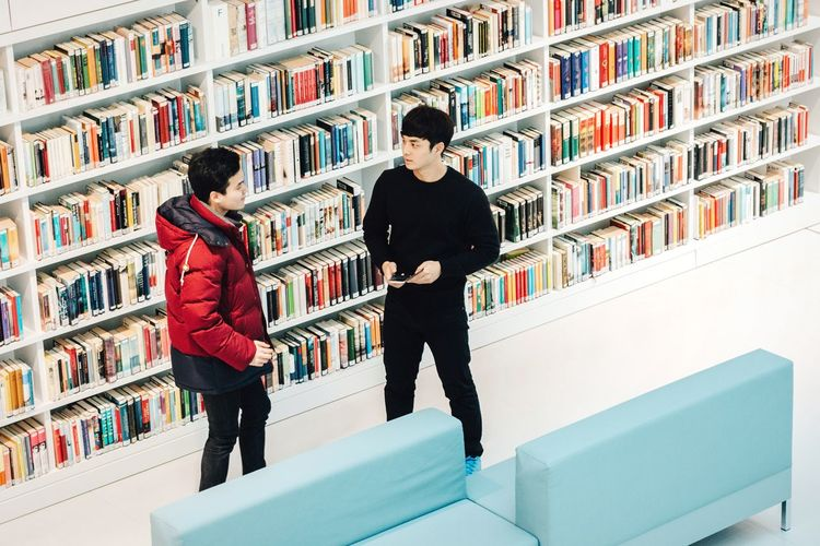 Did you like the book? Bookshelf Two People Library Full Length Education Shelf Adults Only Student University Student People Indoors  Young Adult Adult Real People Friendship University Architecture Stuttgart Asianboy Boys Bookworm Student Discussion Adapted To The City Uniqueness