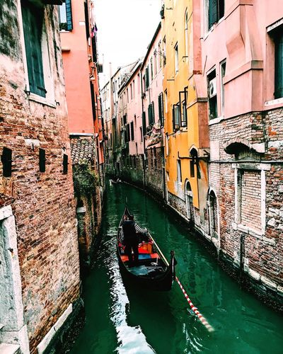 EyeEmNewHere Canal Travel Gondola - Traditional Boat Travel Destinations Architecture Gondolier Built Structure Mode Of Transport Water Tourism Gondola Vacations Outdoors People Day Cultures Building Exterior Transportation Nautical Vessel One Man Only Italy Like First Eyeem Photo EyeEmNewHere