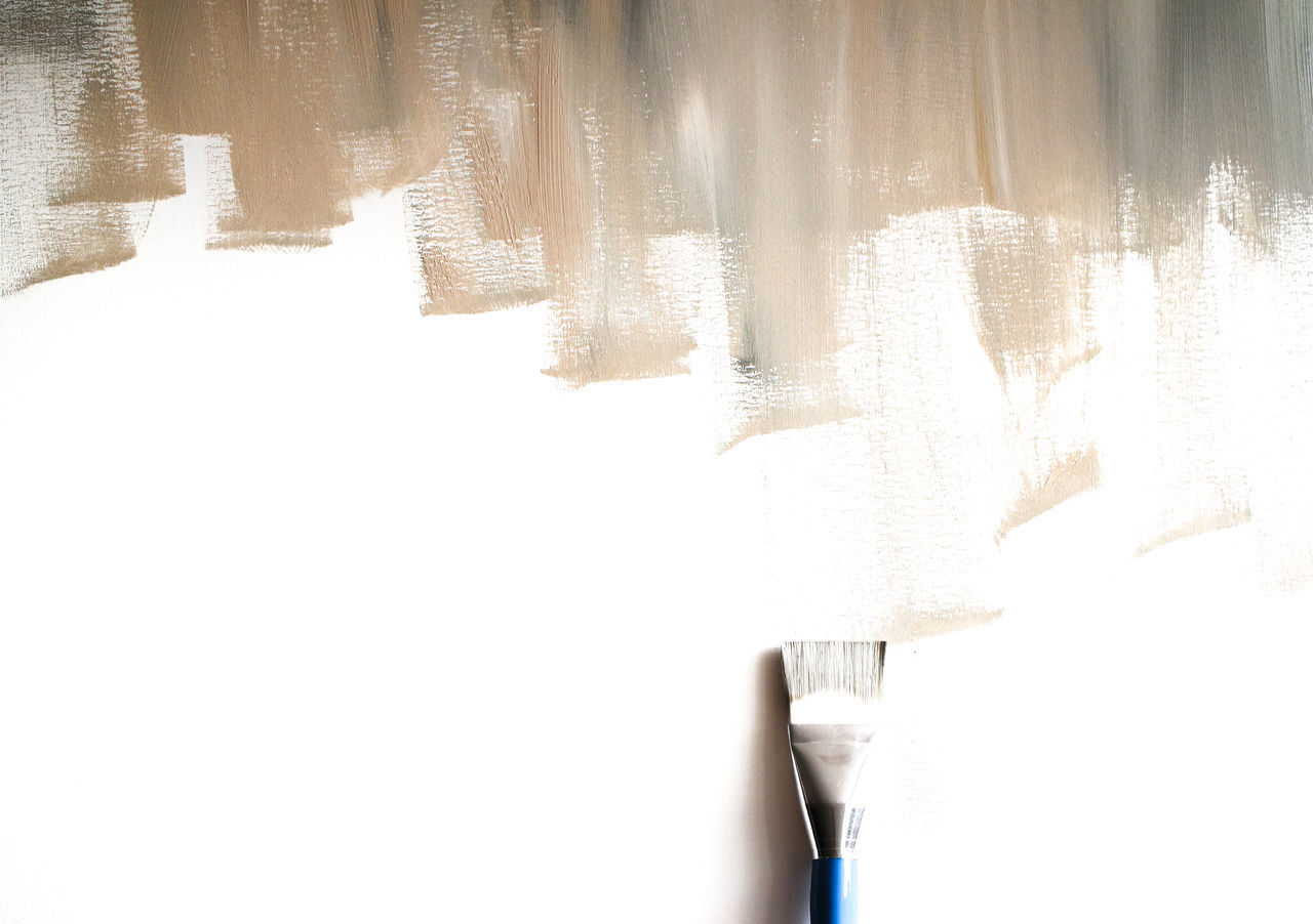 Directly Above Shot Of Incomplete Paint And Brush On White Background