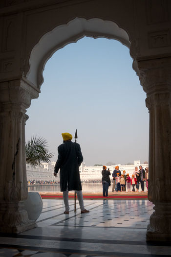 Guard in the Golden Temple, Amritsar, India Amritsar Arch Architecture Golden Golden Temple Guard Gurdwara Harmandir Sahib India Punjab Religion Security Sikh Sikh Temple Sikhism Sunlight Temple Travel Travel Destinations Worship