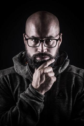 Portrait Of Confident Man Against Black Background