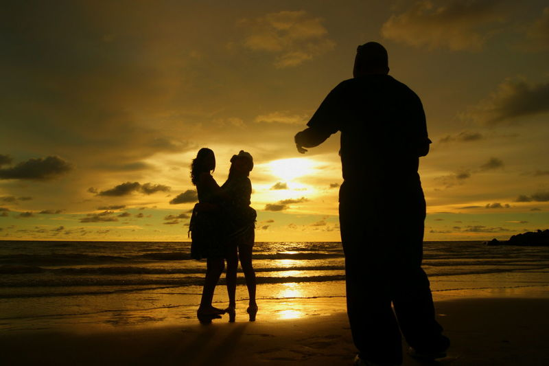 photographer in action shooting the talent at beach Beach Bonding Childhood Cloud - Sky Daughter Family With One Child Father Full Length Horizon Over Water Leisure Activity Lifestyles Love Men Mother Nature Real People Rear View Sea Silhouette Sky Standing Sunset Togetherness Water Women