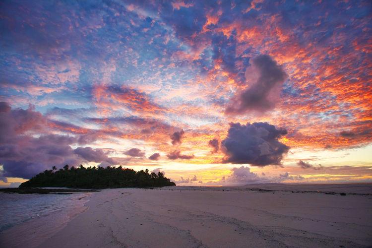 Paradise Beach at the Fiji Islands Fiji Fiji Islands Island Tropic Fiji Sunset Sunrise Sky Beauty In Nature Cloud - Sky Scenics - Nature Tranquil Scene Tranquility Land Idyllic No People Nature Outdoors Beach Orange Color Sea Sand Dramatic Sky Water Non-urban Scene