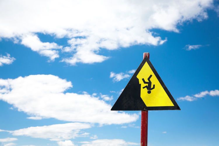 Copy Space Falling High Blue Cloud - Sky Communication Crash Risk Day Falling Down Falling Out Of Clouds Geometric Shape Guidance Low Angle View Nature No People Outdoors Representation Sign Sky Symbol Symbolism Triangle Shape Warning Sign Warning Symbol Yellow