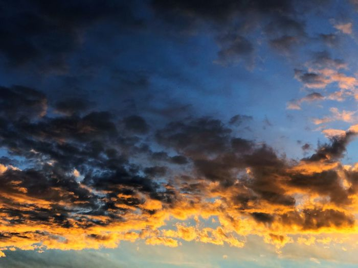 Sky Cloud - Sky Sunset Scenics - Nature Beauty In Nature Dramatic Sky Tranquility Cloudscape Backgrounds Nature Orange Color No People Tranquil Scene Low Angle View Idyllic Storm Atmosphere Dusk Blue Outdoors Abstract Meteorology Abstract Backgrounds Bright