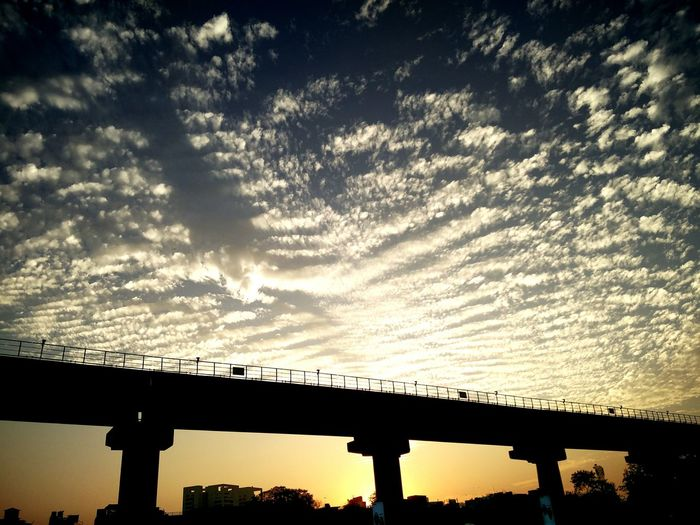 metro track silhouette during sunset Silhouette Cityscape Urban Landscape Urban Gurgaon Rapid Metro Cyber City Clouds Evening Sunset Sky Lovely View Landscapes With WhiteWall The Great Outdoors - 2016 EyeEm Awards The Architect - 2017 EyeEm Awards Dramatic Sky Bridge Railway Bridge Atmospheric Mood Romantic Sky Sky Only