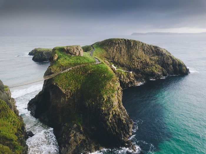 Most famous rope bridge in Northern Ireland. Nature Landscape Northern Ireland Sea Water Beauty In Nature Nature Beach Scenics - Nature No People Rock Rock - Object Land Solid Tranquility Sky Tranquil Scene Day Plant Green Color Island Outdoors Turquoise Colored