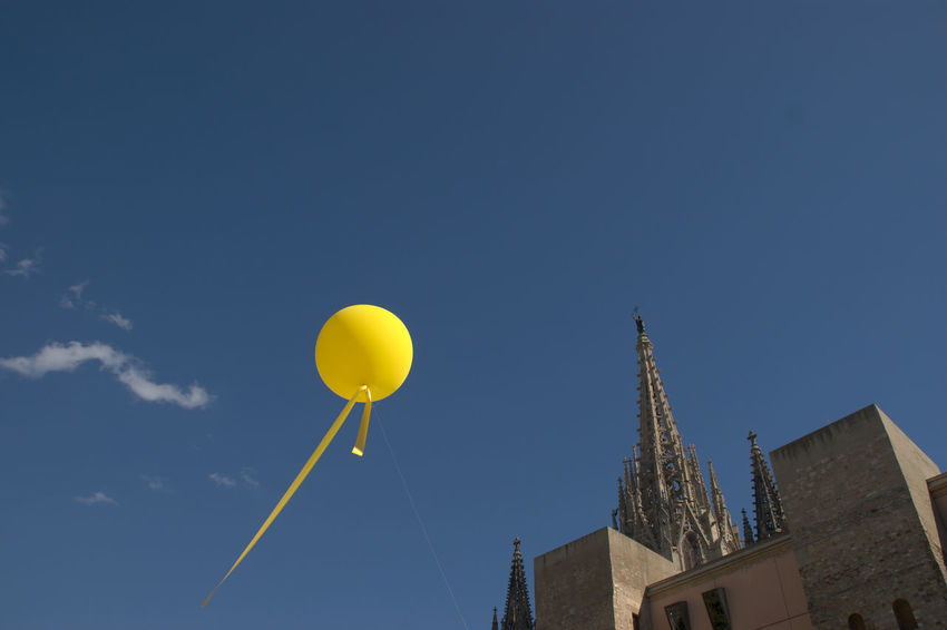 Details of Barcelona Church City Cityscape Dream Dreaming Float Sony A350 Architecture Balloon Blue Building Exterior Built Structure Clear Sky Contrast Copy Space Day Daydreaming Detail Fliying Floating Helium Balloon Low Angle View Sky Street Yellow Rethink Things EyeEm Ready   Adventures In The City