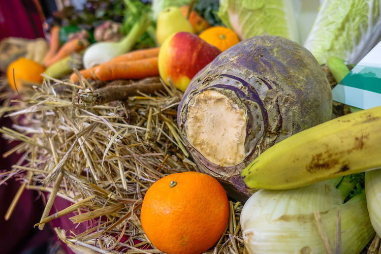 Close-up of fruits and vegetables on straw