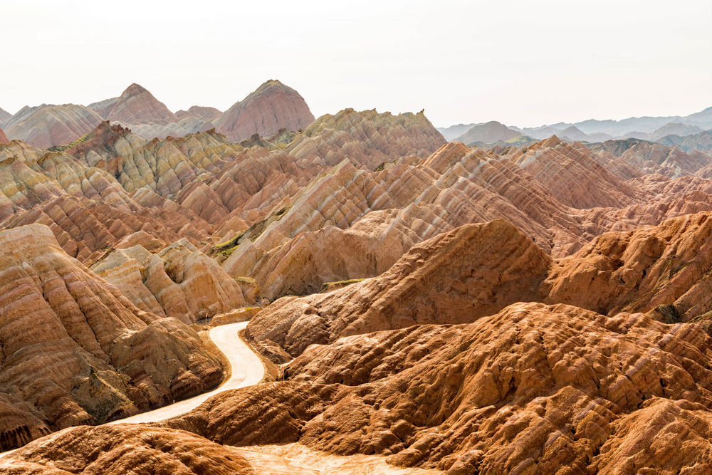 What a roadtrip through this landscape. Zhangye Danxia Landform, Gansu, China Arid Climate China Colour Day Desert Gansu Geological Formation Geology Landscape Mountain Natural Beauty Nature Orange Color Outdoors Path Pattern Physical Geography Red Remote Road Rock Formation High Resolution Travel Destinations Travelling Zhangyedanxialandform
