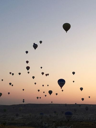 Magical Sunrise Dreaming Cappadocia Baloon Sky Mid-air Flying Balloon Sunset Hot Air Balloon Nature Land Scenics - Nature Air Vehicle Beauty In Nature Tranquil Scene Silhouette Transportation Clear Sky Horizon Tranquility