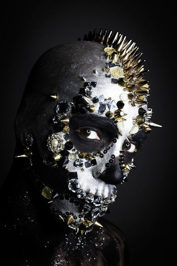 Art And Craft Black Background Body Part Close-up Creativity Dark Disguise Fear Horror Human Representation Human Skeleton Indoors  Mask Mask - Disguise Metal No People Representation Spooky Studio Shot