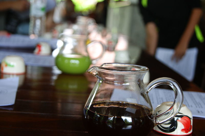 Close-up of black tea in jar on table