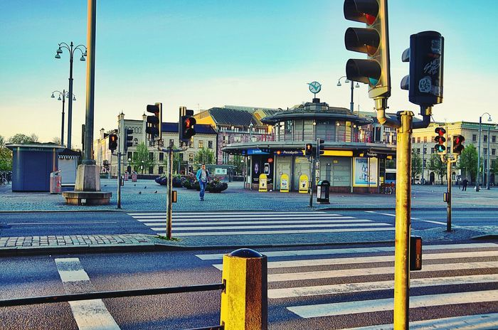 Göteborg, Sweden. Street Road Architecture Battle Of The Cities Built Structure Clear Sky Road Sign Street Light Road Marking Blue Sidewalk Road Signal City Street City Pole Roadside Outdoors Traffic Signal Traffic Light  Crosswalk Morning Morning Light City Sweden Göteborg, Sweden