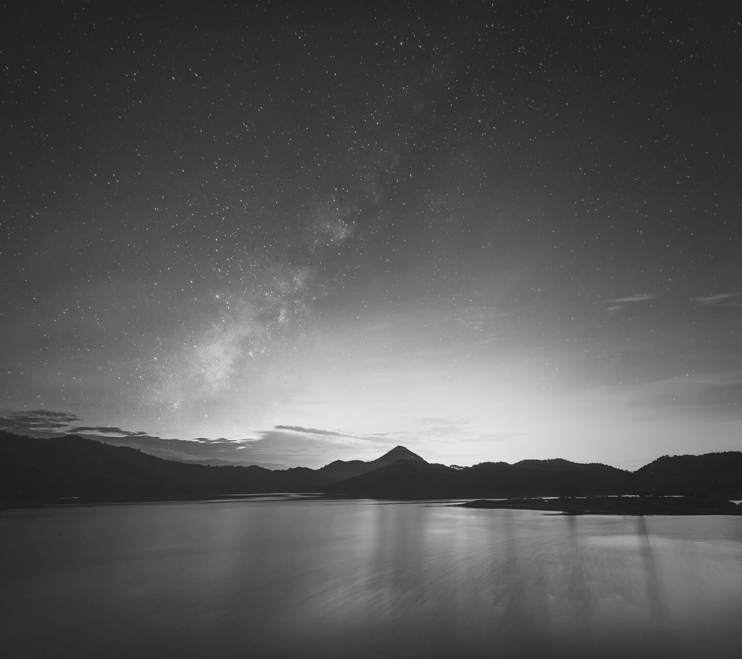 tranquil scene, scenics, tranquility, night, beauty in nature, star - space, star field, sky, nature, water, astronomy, mountain, idyllic, majestic, lake, landscape, mountain range, galaxy, reflection, silhouette