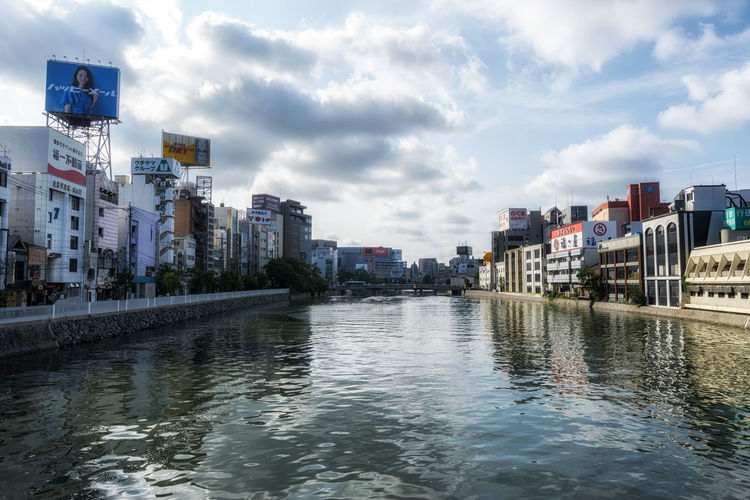 fukuoka naka river morning reflections along the riverside. Taken in fukuoka, Japan on July 25 2018. Japan Japanese  Morning Store Signs Advertisement Architecture Building Building Exterior Built Structure City City Life Cityscape Cloud - Sky Day Fukuoka No People Office Building Exterior Outdoors Reflection River Sky Skyscraper Urban Skyline Water Waterfront