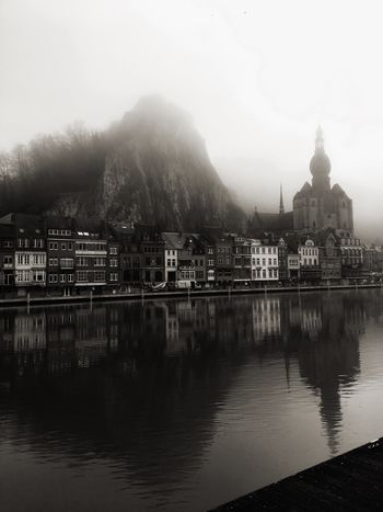 Landscape of Dinant, a pretty village in Belgium, located on the banks of the river Meuse. With views of the citadel and the collegiate church of Notre Dame. River Meuse Vertical IPhoneography Wallonie Traveler Travel Photography Travel Destinations Black And White Blackandwhite Belgium Dinant Belgium Dinant Building Exterior Reflection Travel Destinations No People City