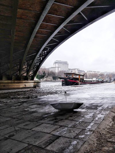 SouslespontsdeParis Rain Rainy Days Umbrella Underthebridge Houseboat La Seine Paris France Architecture River Transportation Built Structure Architecture Mode Of Transport Connection Bridge - Man Made Structure Day Building Exterior Outdoors No People Nautical Vessel Water Sky