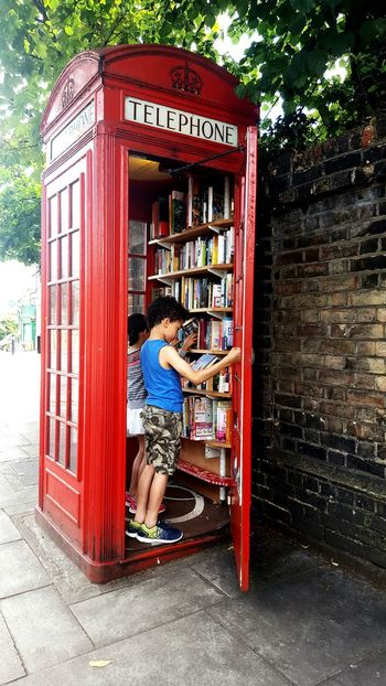 Street library. Ayeshea Bah Outdoor Photography EyeEm Gallery Colours Fresh On Eyeem  Abstract Curious Kids Street Photography Surreal Windows Telephone Box Red Red Phone Boxes Books Library