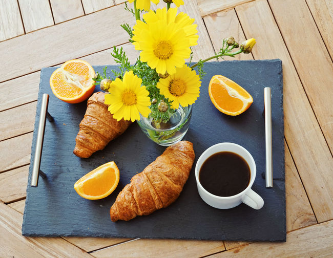 Breakfast with fresh croissant, coffee and orange Good morning concept Breakfast France Morning Orange Black Breakfast Coffee Cup Croissant Day Delicious Drink Flower Food Food And Drink Fresh Freshness Healthy Eating High Angle View Italy Ready-to-eat Salver SLICE Table Time Yellow Food Stories