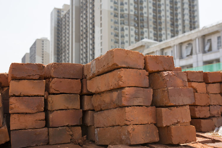 Brick Architecture Built Structure Building Exterior City Building No People Day Nature Outdoors Construction Industry Wall Stack Office Building Exterior Brick Wall - Building Feature Sky Construction Site Industry Pattern Modern Skyscraper Concrete