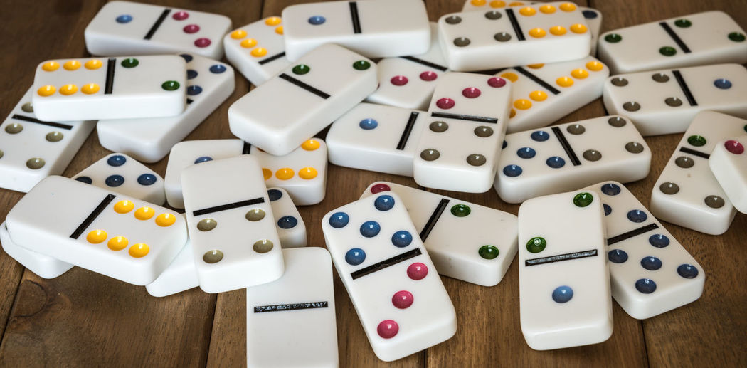 Close-Up Of Dominos On Wooden Table