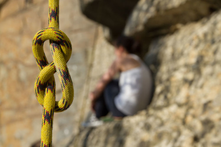 Close-up of rope hanging on rock