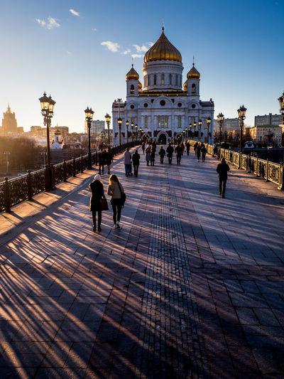People walking on patriarshy bridge leading towards temple of christ the savior