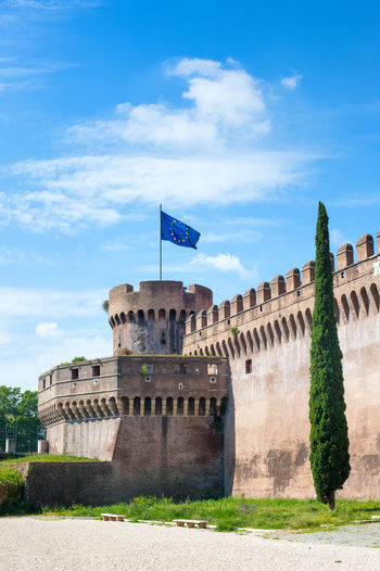 Blue european flag on Castel Sant'Angelo tower Architecture Blackandwhite Built Structure Castel Sant'Angelo Castle Day European March For The Refugees Rights Flags In The Wind  Landmark Monument Outdoors Sky Tower Bridge