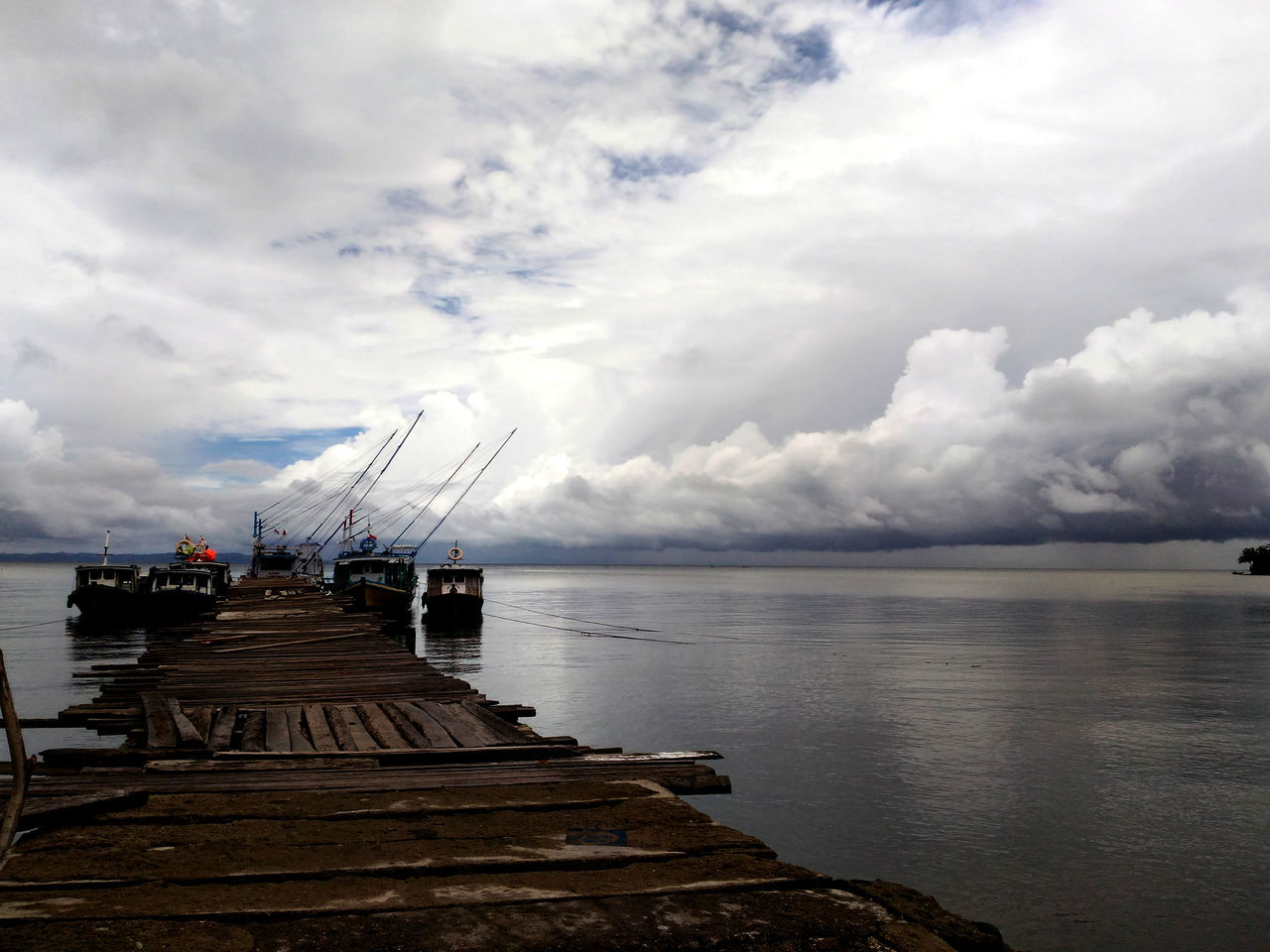 water, sky, cloud - sky, sea, nautical vessel, nature, transportation, pier, no people, scenics, beauty in nature, tranquility, jetty, day, outdoors, horizon over water, harbor