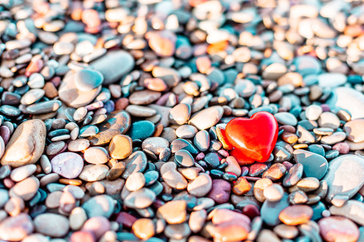 Close-up of heart shape with pebbles