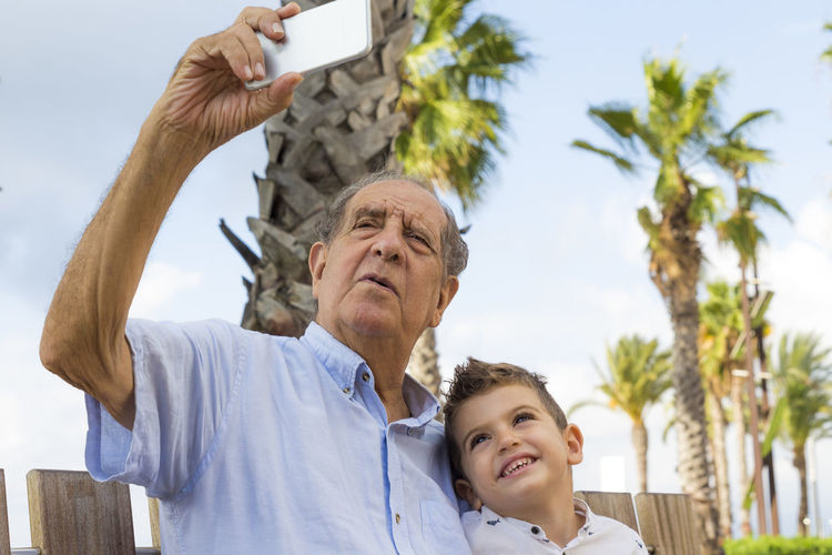 Grandfather Taking Selfie With Grandson