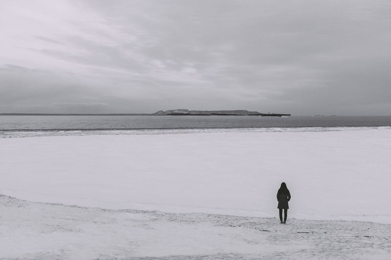 Woman overlooking frozen lake