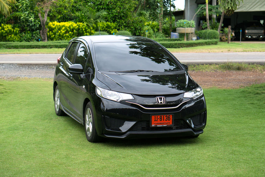 Honda Jazz Architecture Black Color Car City Day Fit Focus On Foreground Grass Green Color Land Vehicle Luxury Mode Of Transportation Motor Vehicle Nature No People Outdoors Plant Silver Colored Sport Transportation Travel Tree White Color