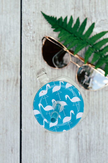 Fashion Blue Close-up Day Decoration Directly Above Drink Drinking Glass Drinking Straws Fern Focus On Foreground Gray Green Color Indoors  No People Pattern Shape Still Life Style Summer Sunglasses Table Wood - Material The Still Life Photographer - 2018 EyeEm Awards The Creative - 2018 EyeEm Awards Creative Space