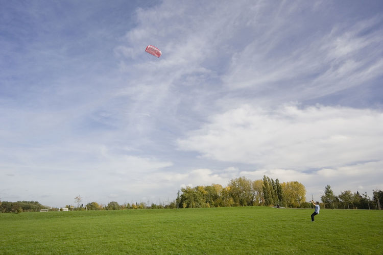 man flying a power kite Activity Flying Fun Gelsenkirchen Germany Grass Kite Kite Flying Kites Kiting Leisure Activity Men Mid-air Nature NRW One Man Only One Person Outdoors People Playing Power Kite Power Kiting  Real People Ruhrgebiet Sport