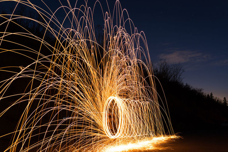 Blurred Motion Burning Communication Dark Fire Firework Display Glowing Illuminated Land Light Painting Light Trail Long Exposure Motion Nature Night No People Outdoors Sign Sky Sparks Spinning Wire Wool