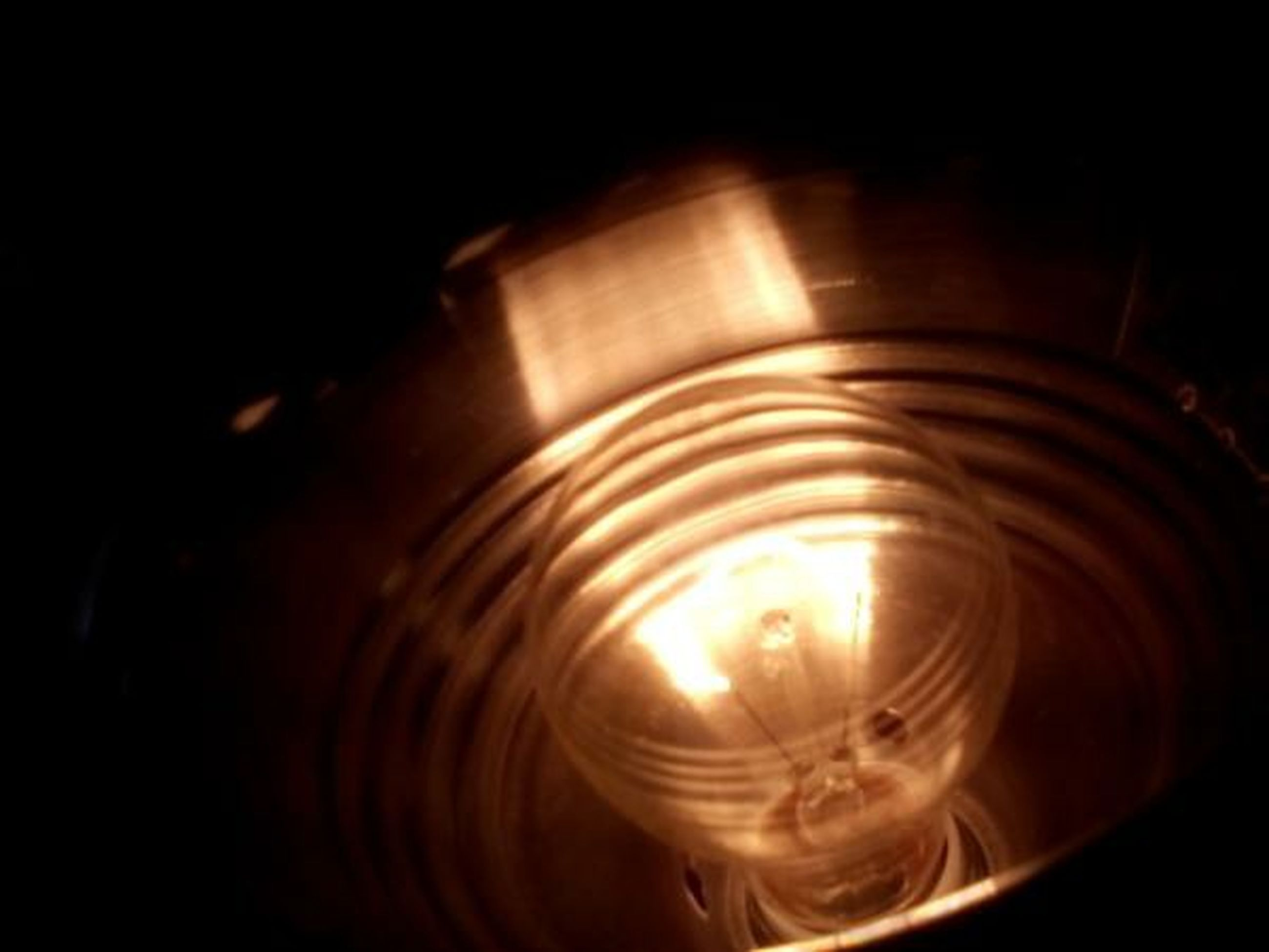indoors, illuminated, lighting equipment, glowing, darkroom, black background, dark, night, studio shot, close-up, electricity, light - natural phenomenon, lit, copy space, light, electric light, no people, glass - material, pattern, reflection
